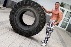 Bodybuilder Resting After Turning Tires Stock Image