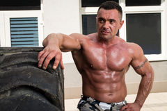 Bodybuilder Resting After Turning Tires Stock Photo