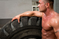 Bodybuilder Resting After Turning Tires Royalty Free Stock Images