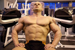 Bodybuilder rests in training room Royalty Free Stock Photos