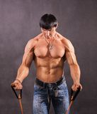 Bodybuilder shakes his shoulders Stock Photography