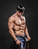 Bodybuilder shakes his shoulders Stock Photos