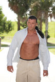 Bodybuilder with shirt unbuttoned. Image of a handsome bodybuilder with shirt unbuttoned Stock Photography