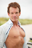 Bodybuilder with shirt unbuttoned Stock Photos