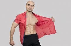 Bodybuilder showing abs. Royalty Free Stock Photos