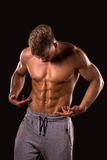 Bodybuilder is showing his abdominal muscle. Muscular man showing his abdominal muscle stock images