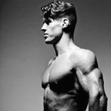 Bodybuilder showing his back and biceps muscles Stock Image