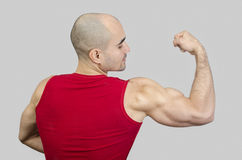 Bodybuilder showing his biceps muscles. Bodybuilder showing his back and biceps muscles Stock Photo