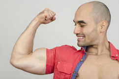 Bodybuilder showing his biceps muscles. Royalty Free Stock Images