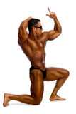 Bodybuilder showing his muscles Stock Photography