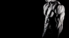 Bodybuilder showing his muscles royalty free stock photo