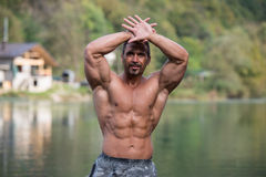 Bodybuilder Showing His Well Trained Body stock images