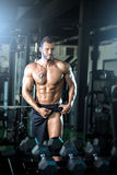 Bodybuilder showing leg muscles Royalty Free Stock Images
