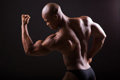 Bodybuilder showing muscles Royalty Free Stock Photo