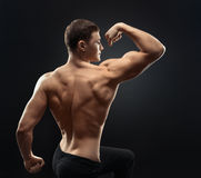 Bodybuilder showing muscles in the arms Stock Photography