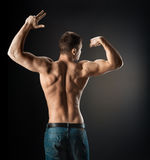Bodybuilder showing muscles in the arms Royalty Free Stock Images