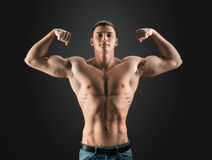 Bodybuilder showing muscles in the arms. And torso Stock Image