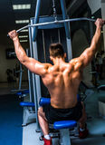Bodybuilder with simulator Royalty Free Stock Images