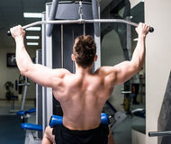 Bodybuilder with simulator Royalty Free Stock Photo