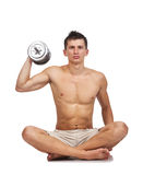 Bodybuilder sitting with dumbbell Royalty Free Stock Images
