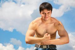 Bodybuilder on sky Royalty Free Stock Photos