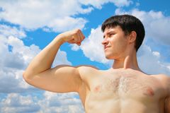 Bodybuilder on sky background Stock Photo
