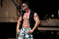 Bodybuilder Smoking A Cigar Stock Photo
