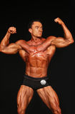 Bodybuilder Strikes Front Double-Biceps Pose Royalty Free Stock Images