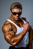 Bodybuilder strong athletic man show muscle arm. Sport guy showing his male muscles Royalty Free Stock Photo