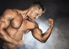 Bodybuilder with strong biceps Stock Image