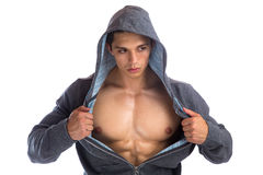 Bodybuilder strong muscular young man hoodie bodybuilding muscle Stock Photos