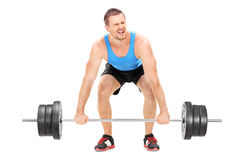 Bodybuilder struggling to lift a barbell Stock Images