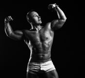 Bodybuilder in the studio Stock Photography