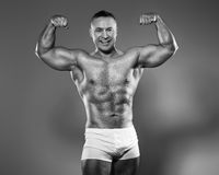 Bodybuilder in studio Stock Images