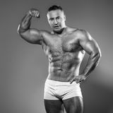 Bodybuilder in studio Royalty Free Stock Images