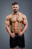 Bodybuilder with tape measure Stock Image