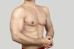 Bodybuilder topless, showing his muscles. Stock Photos