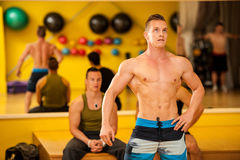 Bodybuilder train posing before the competition Stock Photography