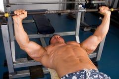 Bodybuilder training. In gym -bench press Royalty Free Stock Photos