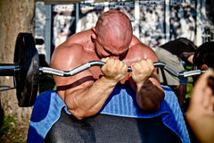 Bodybuilder training. SIOFOK - AUG 4: Kokeny Bela participate in Scitec Muscle Beach bodybuilding seminar on August 4, 2012 in Siofok, Hungary royalty free stock photo