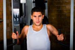 Bodybuilder training on chest machine. Bodybuilder man training on chest press machine royalty free stock photo