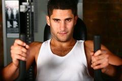 Bodybuilder training chest muscles. Bodybuilder training on chest press machine stock photos