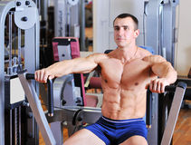 Bodybuilder training chest on simulator Stock Photos