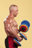 Bodybuilder training with dumbbells Stock Photos