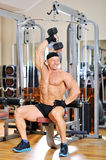 Bodybuilder training in a gym. Indoors royalty free stock image
