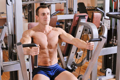 Bodybuilder training at gym Stock Photo