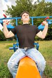 Bodybuilder training in park Stock Image