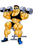 Bodybuilder trains hard with weights Royalty Free Stock Photo