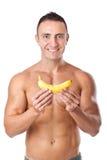 Bodybuilder und Banane lizenzfreie stockbilder