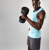 Bodybuilder using heavy dumbbell Stock Image